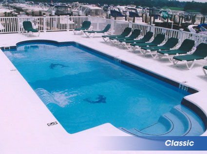 Classic shaped inground swimming pools